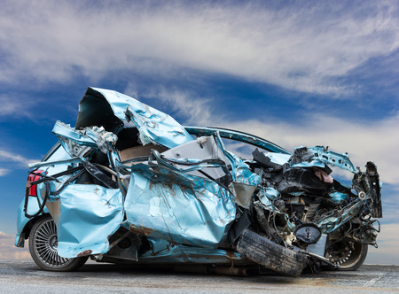 Light blue saloon crashed, demolished by accident, collided with another vehicle and the sky was the scene. Reklamní fotografie