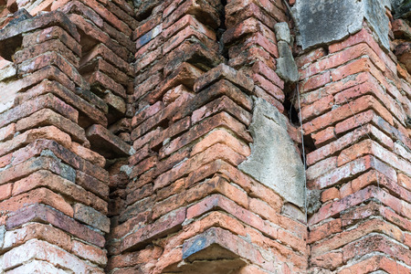 Close-up image of the ruins of a large brick wall of the old Buddhist church.