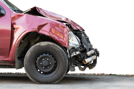 Close-up image of front wheel of red car on the road, which was severely demolished by accident.