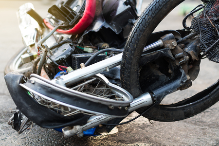 Close-up of the front of the motorcycle destroyed the distorted wheel of a serious accident until the driver died. Stock Photo