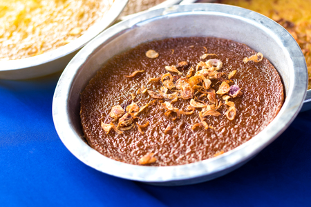Baked Thai Custard in a tray of aluminum, which is a popular sweet food in Thailand, often seen in the market. Stock Photo