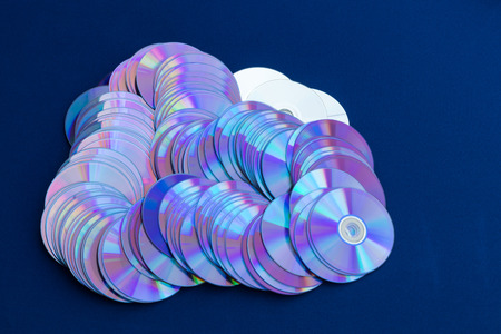 Old DVD backgrounds are used to reflect the colorful colors stacked over the blue cloth.