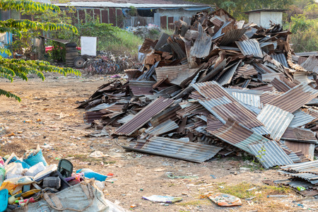 Many of the galvanized roofs that had been rusted were left to be left waiting for a new recycle in one of the antique stores in Thailand. Imagens