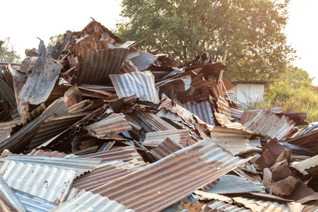 Many of the galvanized roofs that were rusted were left to be left waiting for a new recycle near the early morning tree.