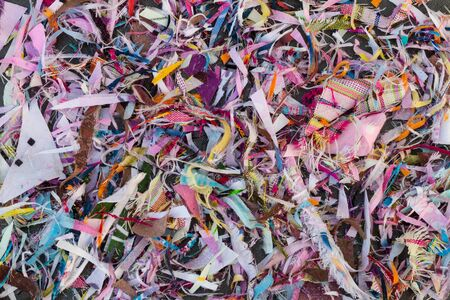 Background, thread remnants and many colorful pieces, which come from sewing, repair, pile together.