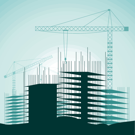 Construction site with buildings and cranes.