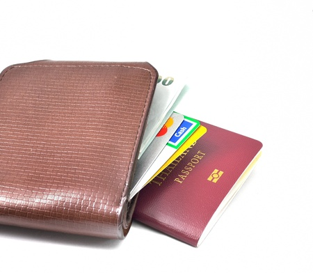 Passport and wallet with credit cards, money photo