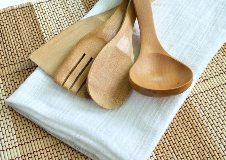 Wooden cooking utensils on wood background photo