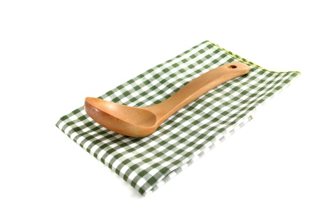 Wooden cooking utensils on fabric, isolated