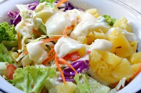 Hawaiian salad with salad dressing photo
