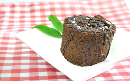 Chocolate roll cake on plate Stock Photo