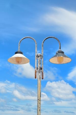 lampposts: Dos postes de luz en el cielo Foto de archivo