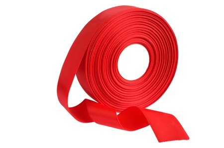 Scarlet ribbon roll on a white background