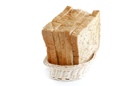 slice of whole wheat bread in basket photo