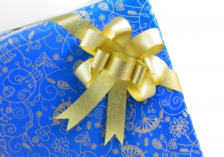 blue gift box with golden ribbon