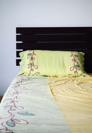 Empty and messy bed with green pillow Stock Photo - 18115772