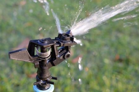 Sprinkler equipment of water in garden photo