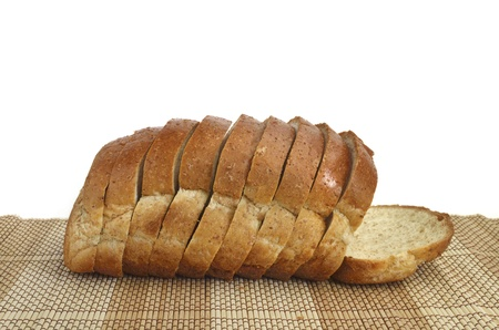 sliced whole wheat bread on wood background