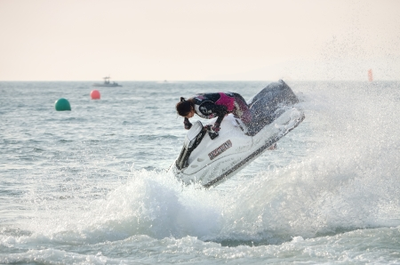 PATTAYA CITY THAILAND - DECEMBER 8, 2013    A women rider of Japan in action during Class Pro Freestyle the Jetski King
