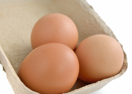 Fresh eggs with a carton box photo