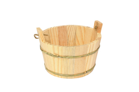 Wooden bucket isolated on white photo