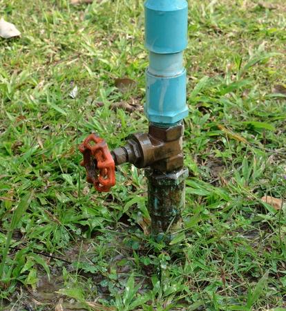 Leaking valve on the garden photo