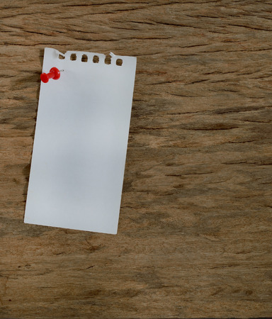 Blank notepad on a wooden surface, grunge background
