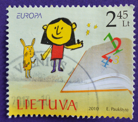 LITHUANIA - CIRCA 2010 A stamps printed in Lithuania shows girl reading a book as a part of stamp issued in the series of Europa 2010, circa 2010