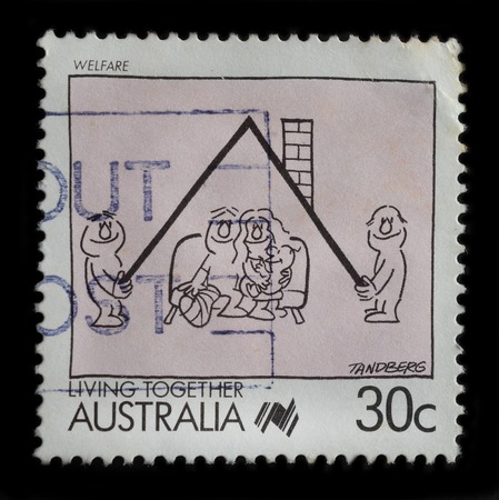 AUSTRALIA - CIRCA 1988 : a stamp printed in AUSTRALIA shows the Caricature of Welfare, Cartoons series, circa 1988