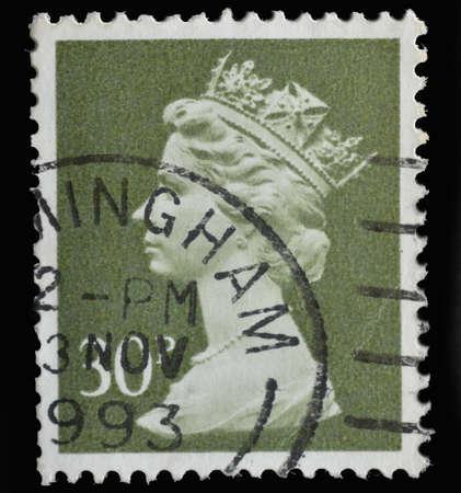 queen elizabeth ii: UNITED KINGDOM - CIRCA 1971 : postage stamp printed in United Kingdom showing Portrait of Queen Elizabeth II in red, circa 1971.