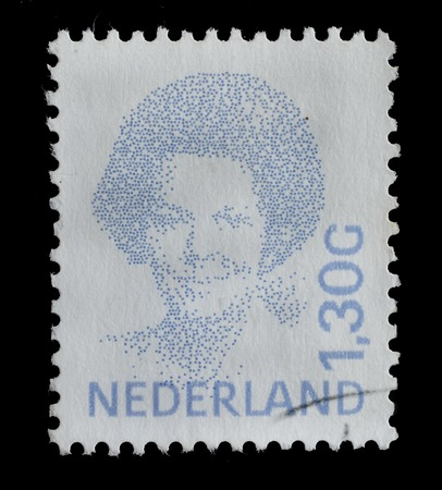 beatrix: NETHERLANDS - CIRCA 1991 : postage stamp printed in the Netherlands shows a portrait of Queen Beatrix, circa 1991