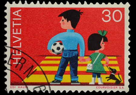 helvetia: SWITZERLAND - CIRCA 1969   postage stamp printed in Switzerland shows Children Crossing Street, Traffic Safety Campaign, circa 1969 Editorial