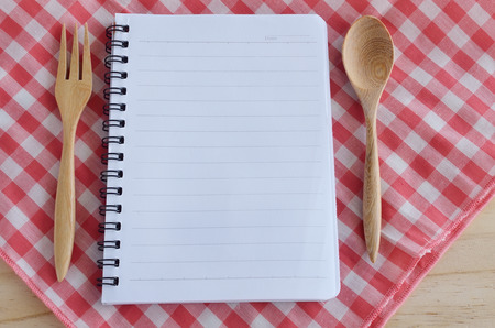 cooking implement: blank book with wooden spoon utensils