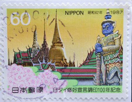 philatelist: JAPAN - CIRCA 1987 : postage stamp printed in Japan shows The Temple of the Emerald Buddha with sakura flowers(The memorial of centenary of the Japan-Thailand Friendship Declaration), circa 1987