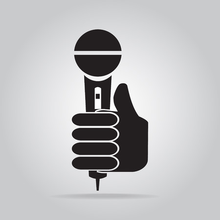 answering: Hand holding microphone icon, interview answering question concept