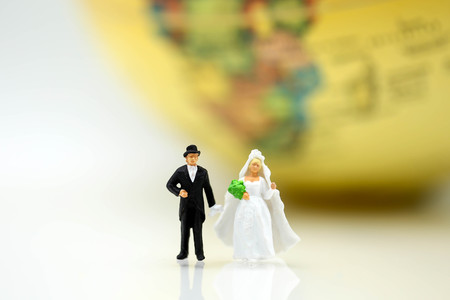 Miniature  people : love couple stand with globe world map balloon background,travel and lovely concept.