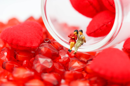 Miniature people: Couple and valentine decorations character with copy space using as background valentine day, Love couple concept Stock Photo