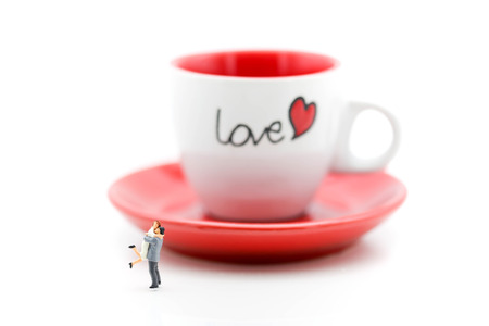 Miniature people : Couple Lover standing with cup off coffee, lovely concept.