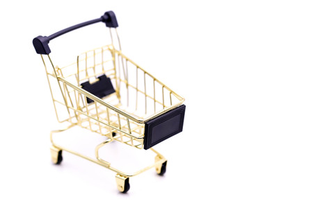 A Mini Shopping Cart Isolated On White background. Stock Photo