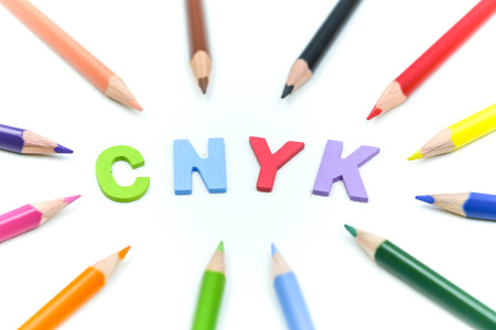 Close up Color pencils with Colorful wooden English alphabe on white background.