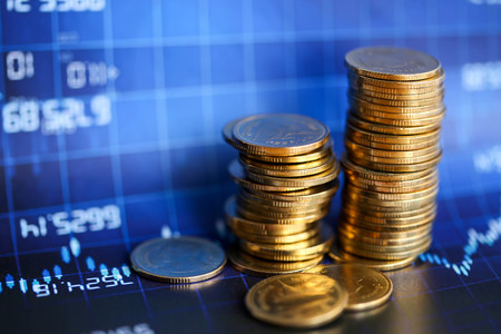 Stack of coins with Finance  graph background.