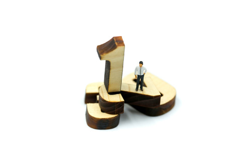 Miniature people : Businessman standing wooden number of 1,2,3