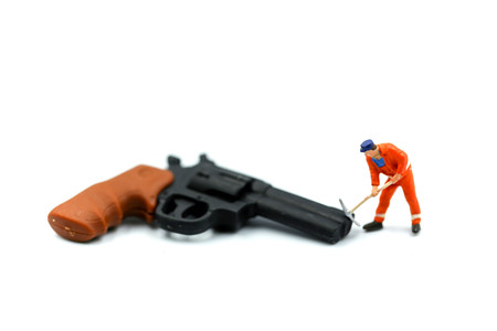 Miniature people : Worker with a gun.