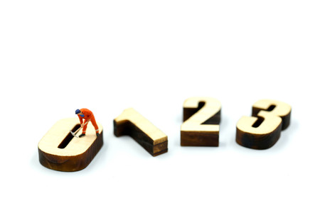 Miniature people : Worker digging a wooden number 1,2,3 Stock Photo