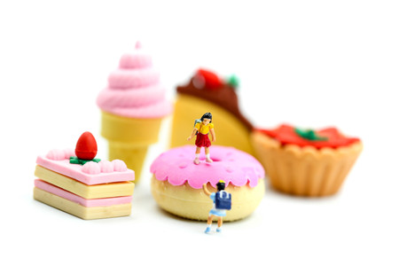 Miniature people : children,student with dessert.fun and food concept.