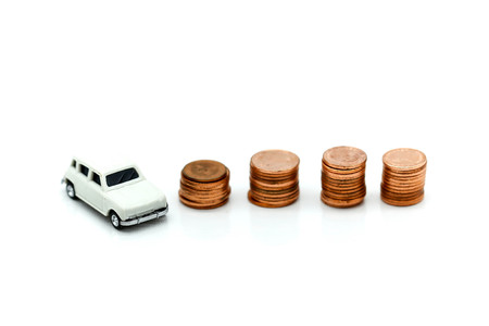 Miniature car model and stack of coins,Finance and car loan, saving money for a car