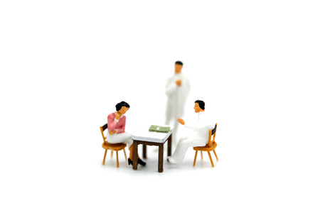 Miniature people: Woman having consultation with doctor,health care Medical concept.