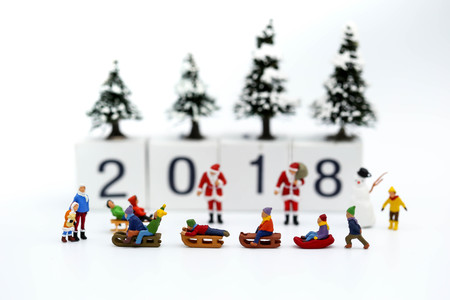 Miniature people : Children with Merry christmas and happy new year 2018
