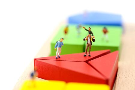 Miniature people : children with wooden block toy, Education concept. Reklamní fotografie