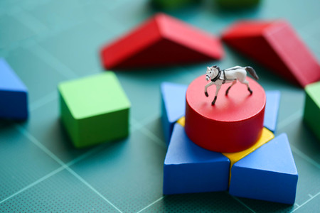 Miniature people : children with wooden block and mini toy horse, Education concept.